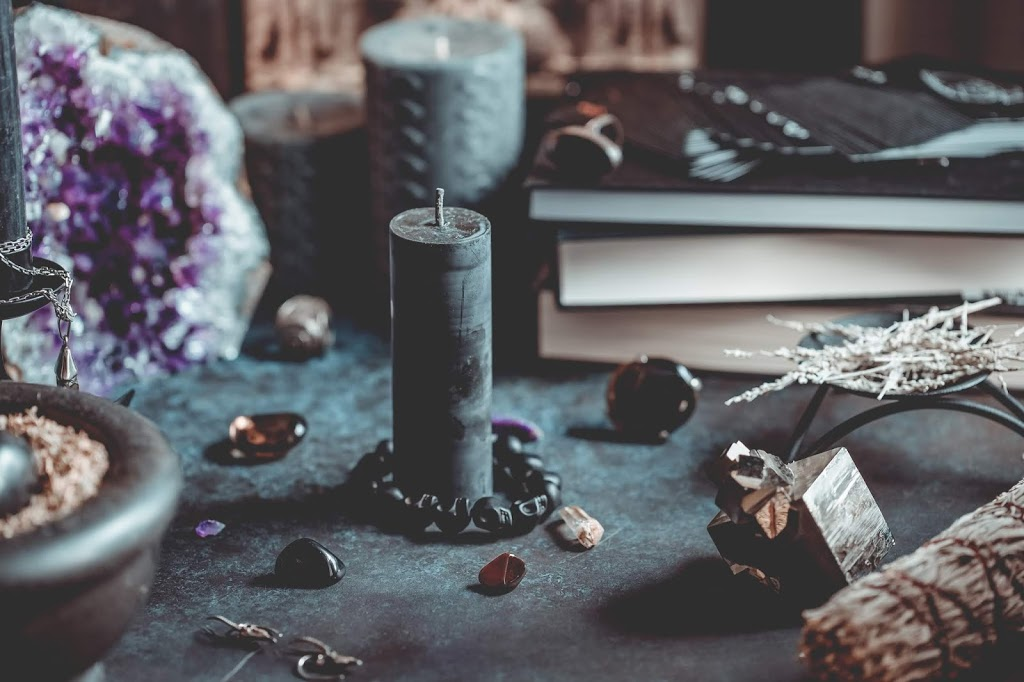 black candle on a witchs altar for a magical 4F2RSXV - Writing Your own Original Spells